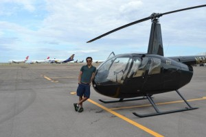 Divyank posing next to the helicopter he did not fly from NYC to LA.