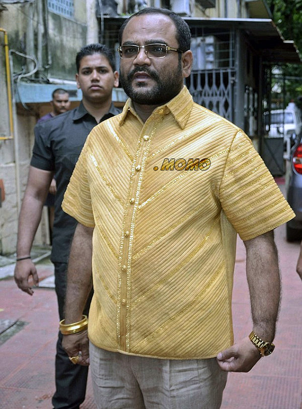 Puranjay Raja Bibek sporting a gold shirt and the dot .Momo gTLD.