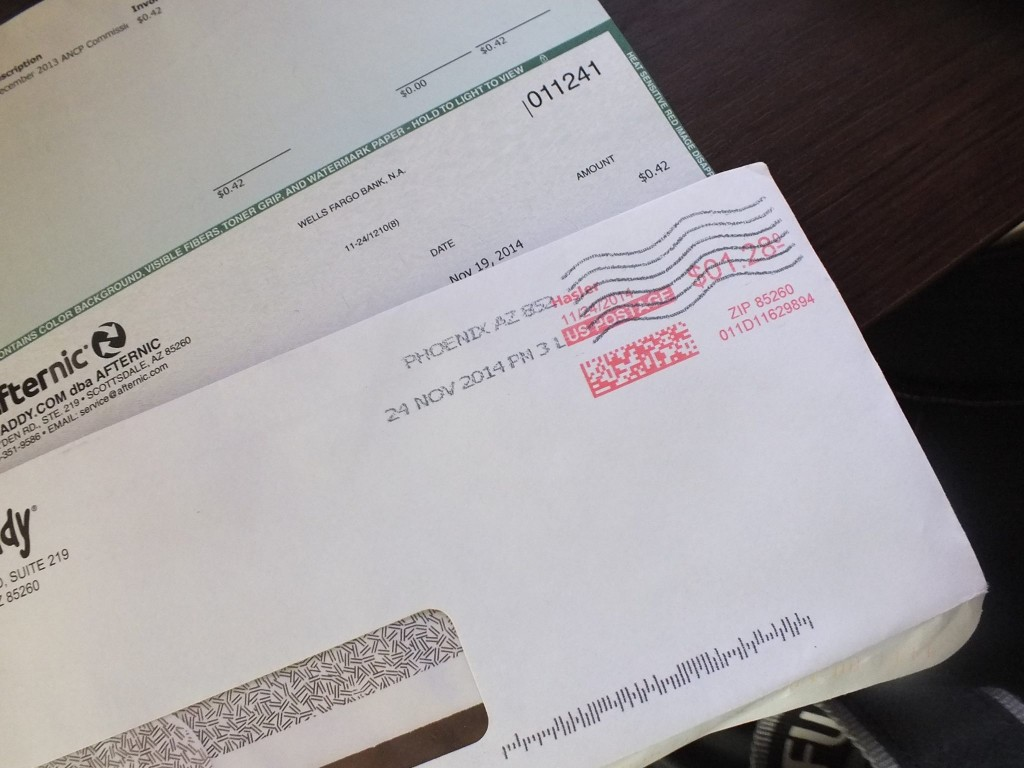 A check from GoDaddy for the amount of $0.47 cost $1.28 to mail.